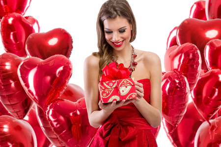 anniversary sexy: Happy woman looking at her gift for Valentine�s day