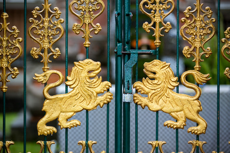 looked: Gold carved lions at the gate of the Hindu temple