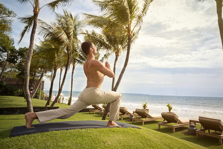 and the horizontal man: Yoga man at tropical beach doing yoga exercise