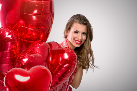 peeking: funny Valentine?s Day woman  peeking behind a red balloons