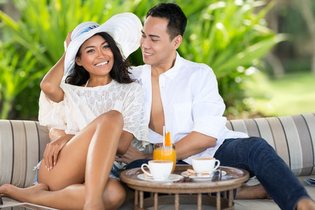 lounges: Romantic couple relaxing on lounges Stock Photo