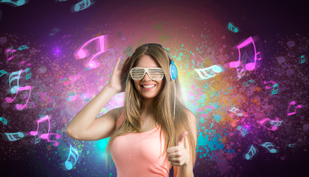 headset voice: Happy girl enjoying in music over abstract background Stock Photo