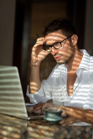journalists: Thinking handsome men looking at laptop, businessman in home office