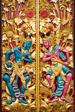 sanctuary: carved detail of guard mythological god on Balinese temple door Stock Photo