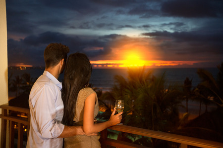 couple in love enjoying in sunset  in a terrace photo
