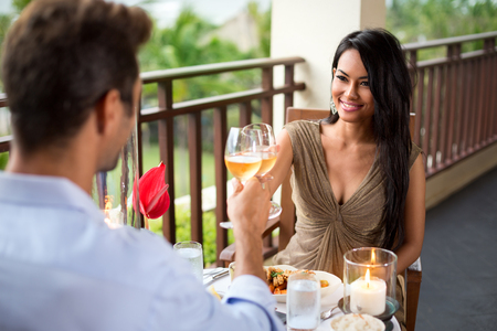 Affectionate couple toasting their love on romantic dinner photo