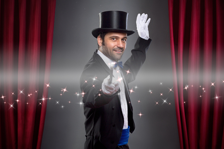 conjuror: Magician  in costume showing spectacular trick Stock Photo