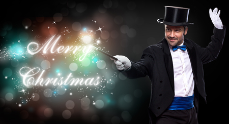 conjuror: magician with a Christmas magic, trick for Merry Christmas