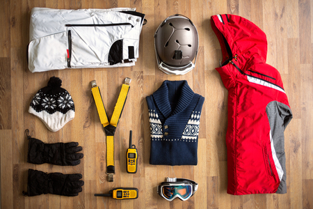 clothes winter: top view travel items on the floor for mountain trip