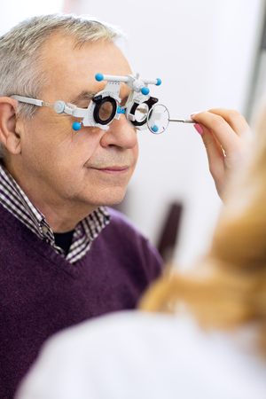 ophthalmic: Ophthalmic doctor measure distance of eyes pupil in consulting room