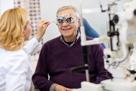 ocular: Ocular female specialists work with patient in pleasant atmosphere on eye clinic
