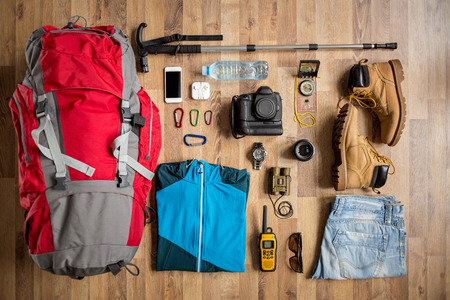 groups of objects: top view travel things on the floor for mountain trip