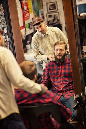 barber scissors: Stylish man in a barber shop ready for new haircut