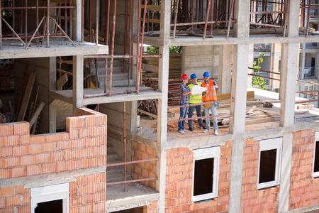 in the open air: Young monitoring team checking blue print on open air building construction  architects, young, team, Stock Photo