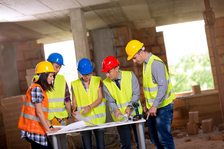 discussing: Group of engineers and architects working together Stock Photo