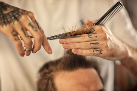 barber scissors: close up haircut at barber shop with scissors Stock Photo