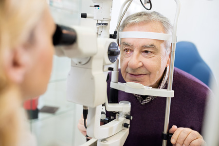 ambulant: Young female eye specialist determines distance of eyes pupils to patient