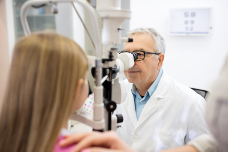 determines: Eye specialist determines diopter to girl in eye clinic