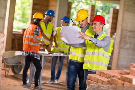 consider: Architect and investiture of construction consider possibilities at  construction site