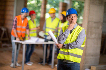 protective work wear: Male architect design architectural solution on construction site