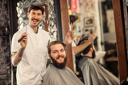 barbershop: Great time at barbershop with barber and customer Stock Photo