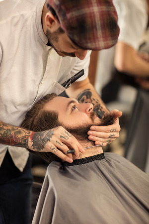 barber: barber with razor a shave Stock Photo