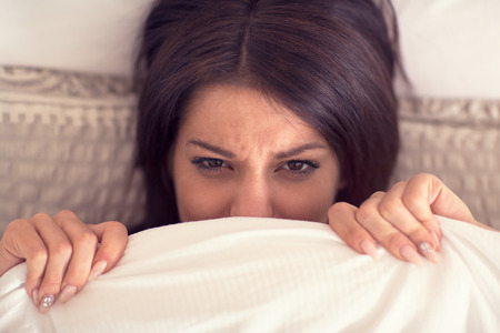 hardly: Young pretty female wake up hardly from bed in early morning