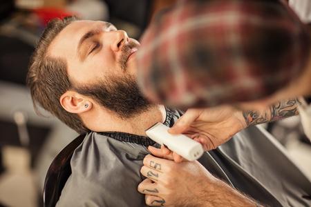 barbershop: professional grooming of real man in barbershop Stock Photo