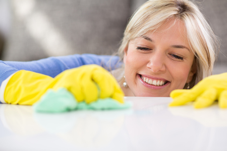 worthy: Close up of worthy housewife cleans table in apartment Stock Photo
