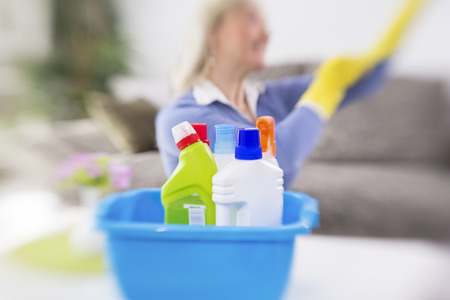 cleaning service: Woman from cleaning service prepare cleaning products for cleaning house Stock Photo