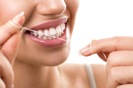 floss: Cleaning teeth with dental floss, perfect healthy tooth Stock Photo