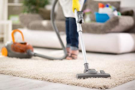Close up of vacuuming carpet with vacuum cleaner Archivio Fotografico