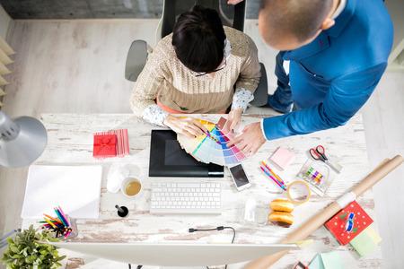 Two employers in designer photo studio processing
