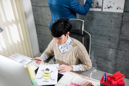 color consultation: woman graphic designers working in office Stock Photo