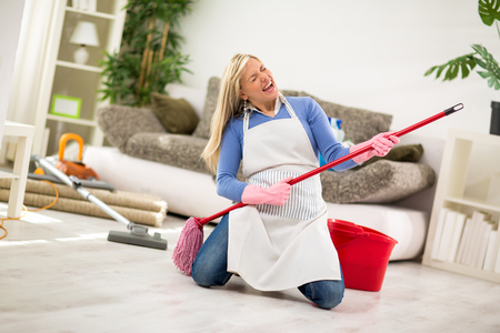 Humorous housewife with jogger stick make joke Stock Photo - 54014566