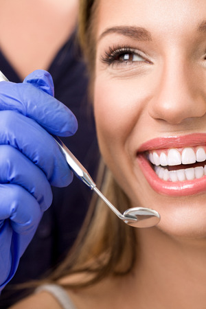 woman with healthy teeth at dentist, dental care