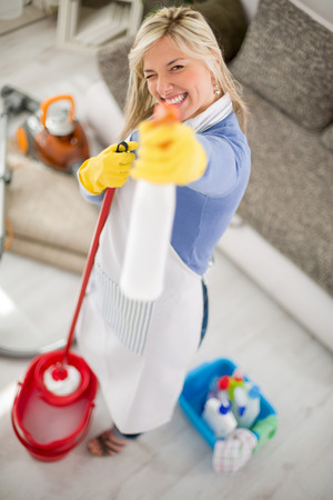 professionally: Nice fanny hostess make joke with products for cleaning house