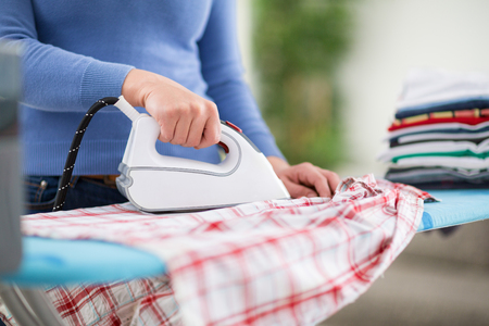 professionally: Woman from ironing services professionally iron clothes Stock Photo