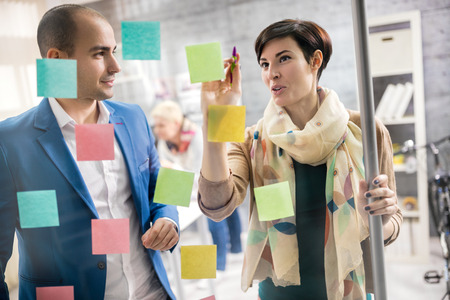 Designer discus about artistic plan with colleague in workplace