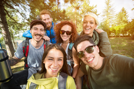 group photo: Group photo of cheerful smiling hikers in woods