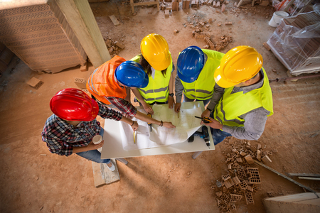 Top view of construction team with colorful hard hat on building construction Фото со стока