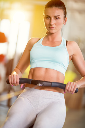 woman working: woman working out on machines at healthy club Stock Photo