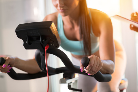 Young women doing sport biking in the gym for fitness Stock Photo
