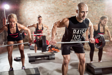 Group training with weights, young people on body pump training Foto de archivo
