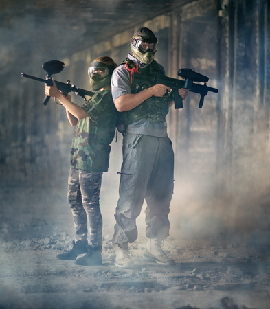 shooters: Two paintball shooters with paintball guns Stock Photo