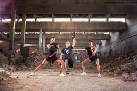 Active sport people has condition training with weights in hangar Stock Photo