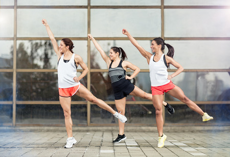stretching condition: Athlete girls training aerobic outdoor