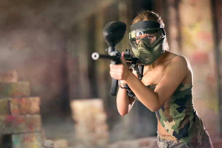 paintball: Paintball, female player with marker gun