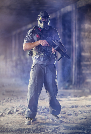 paintball: Paintball  man player with marker gun Stock Photo