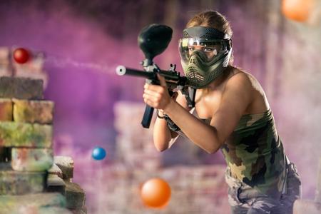 Paintball player shootout from marker gun